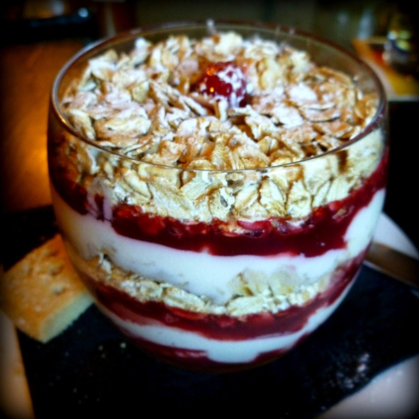 Cranachan: Whiskey, cream, raspberries and toasted oatmeal are layered in a tall glass.